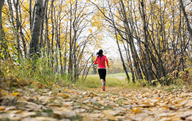 Woman running in Fish Creek Park