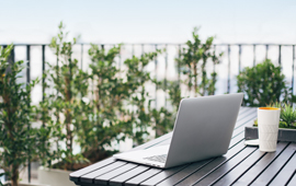 Laptop sitting on outdoor table